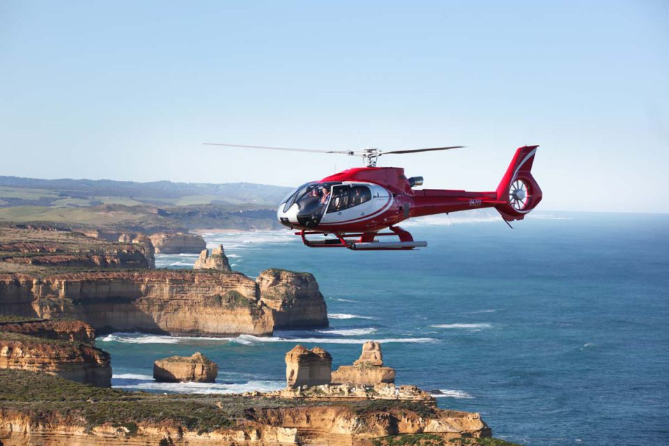 Take in the stunning landscape and the Twelve Apostles from the air on a helicopter tour with Great Walks of Australia.