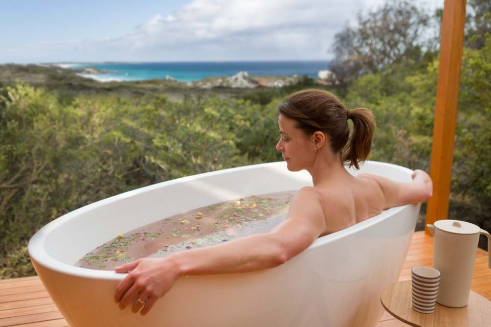 Bathe in your private outdoor bathtub and enjoy ocean views from the Bay of Fires Lodge.