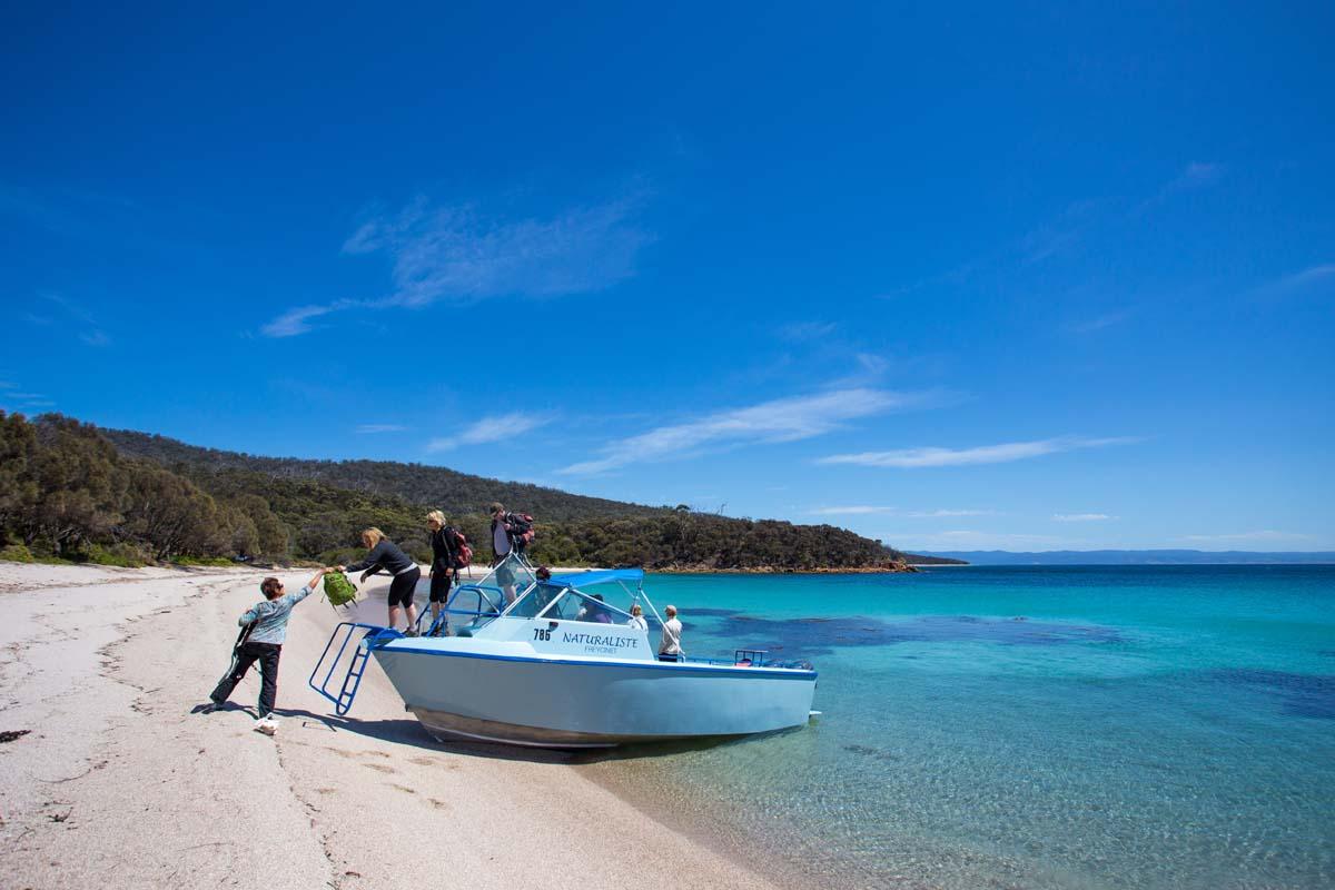 Take a boat trip to Shouten Island, Tasmania on the Freycinet Experience Walk.