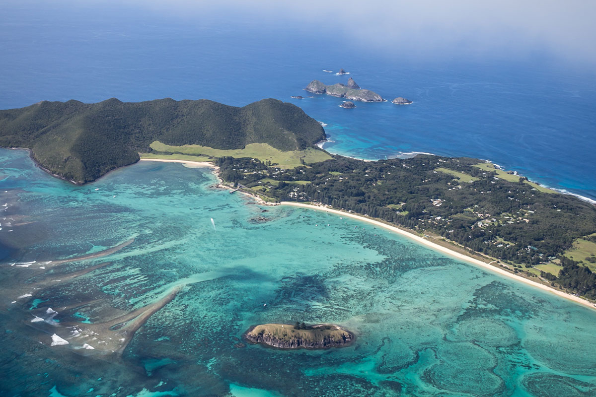 Take in stunning views as you fly over Lord Howe Island on arrival.
