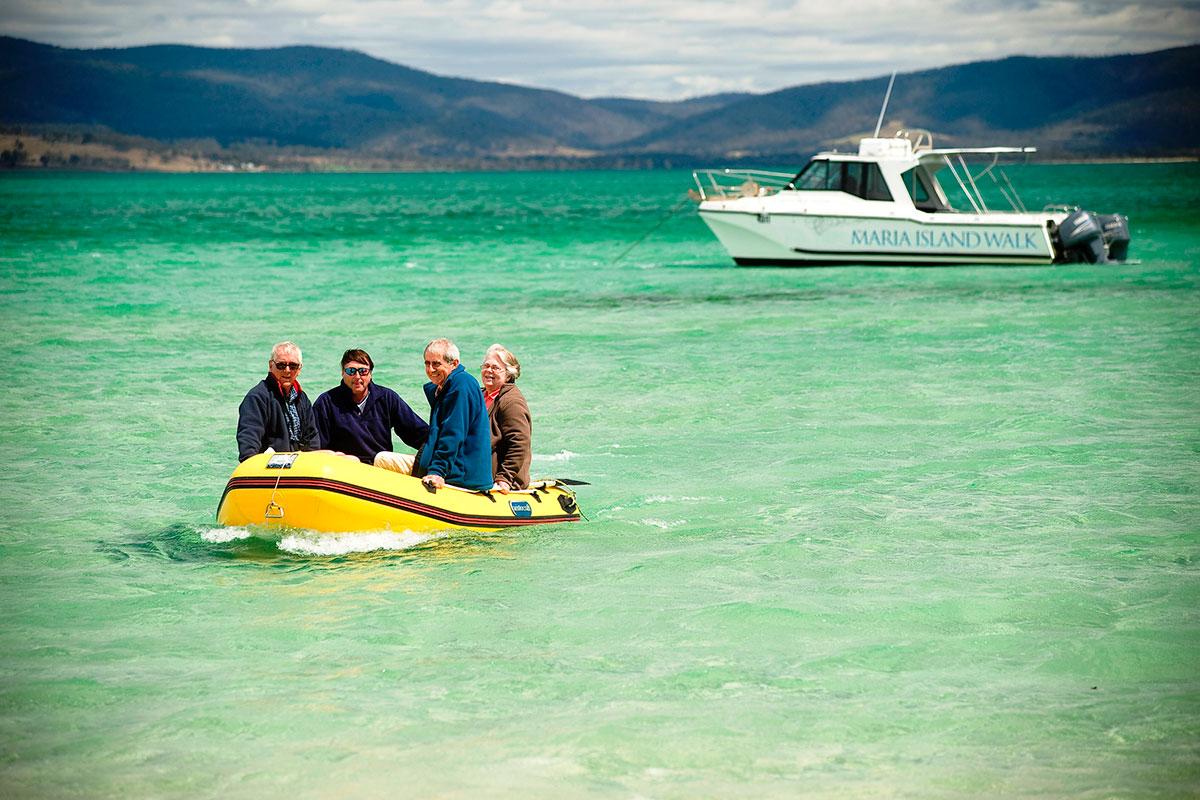 Travel by boat through Mercury Passage to Maria Island in Tasmania.
